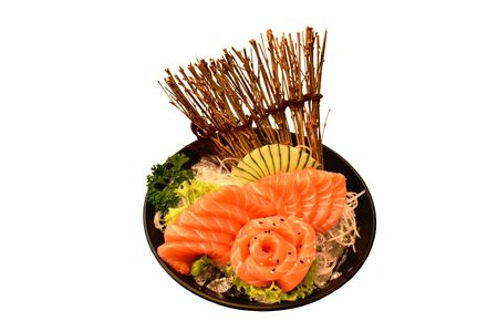 fresh slice salmon sashimi Japanese food serving on ice in bowl with white background Фото со стока