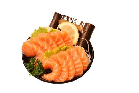 fresh slice salmon sashimi Japanese food serving on ice in bowl with white background