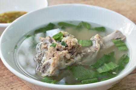boiled  pork bone in clear soup on bowl