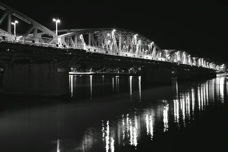 bridge cross river and reflection light bulb on night in Vietnam 版權商用圖片