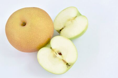 green apple healthy fruit half cut on white background