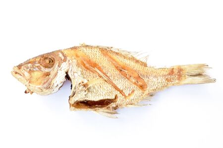 deep fried salty bass fish with garlic on white background Stockfoto