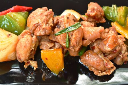 spicy fried crispy chicken with bell pepper on plate