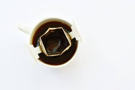 hot coffee drip powder with filter in cup on white background