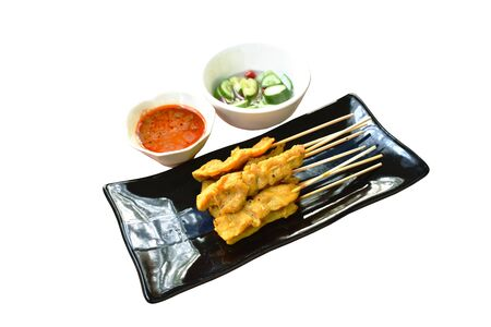 pork satay with sweet peanut sauce and pickled vegetable cup