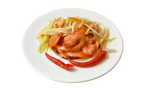 spicy dried shrimp with slice mango fruit salad on plate