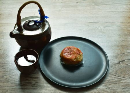 Chinese pastry stuffed chop winter melon and salty egg with hot tea cup