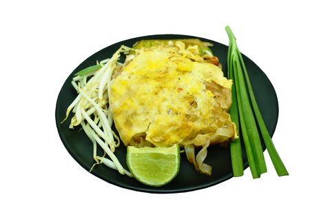 Pad Thai stir fried rice noodles with dry shrimp wrapped with egg on plate Banco de Imagens