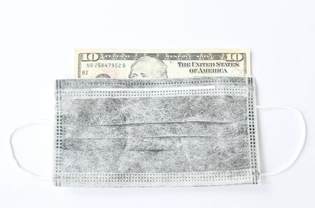 hygienic mask for protection nose and mouth cover ten US dollar banknote on white background