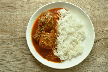 chicken leg spicy and sweet curry or mussaman eat with plain rice on dish 写真素材