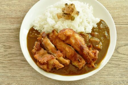 deep fried chicken dressing with Japanese curry on rice topping slice pickled cabbage