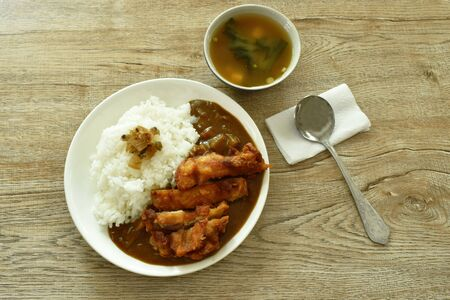 deep fried chicken dressing with Japanese curry on rice topping slice pickled cabbage and miso soup