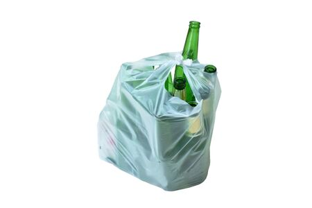 empty beer bottle in plastic bag garbage on white background