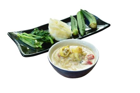 herb soybean sauce with minced shrimp and chop pork in coconut milk sauce served couple boiled vegetable on plate