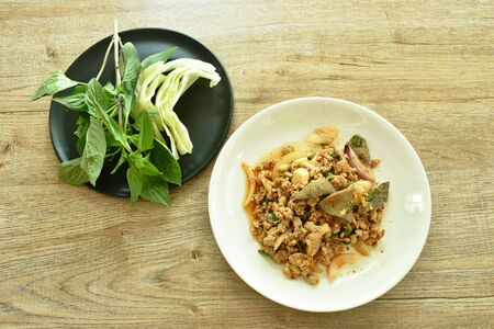 Thai spicy minced pork salad and fresh vegetable on plate