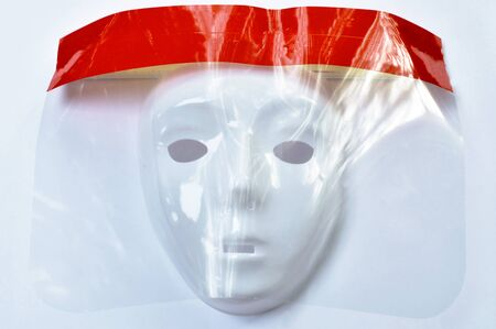 mask wearing plastic face shield for protection coronavirus or COVID -19 on wgite background