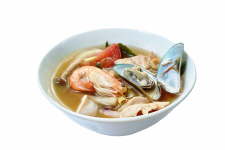 boiled shrimp and chicken with mussel in Thai spicy tom yum soup on bowl