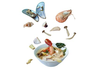 boiled shrimp and chicken with mussel in Thai spicy tom yum soup floating on bowl
