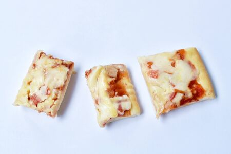 piece of pizza topping sausage and cheese on white background