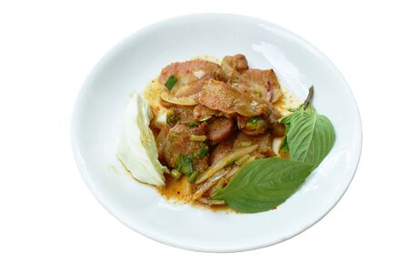 spicy roasted pork Thai salad eat with fresh cabbage and basil ltaf on plate