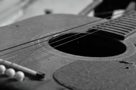 old guitar and broken string in home