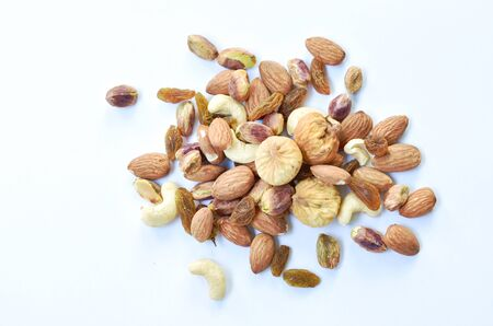 mixed nuts and dry raisin with fig on white background