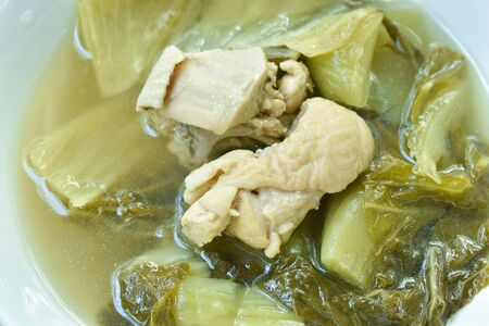 boiled pickled cabbage with chicken meat in clear soup on bowl Foto de archivo