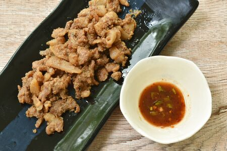 steamed slice pork with belly on plate dipping spicy sauce