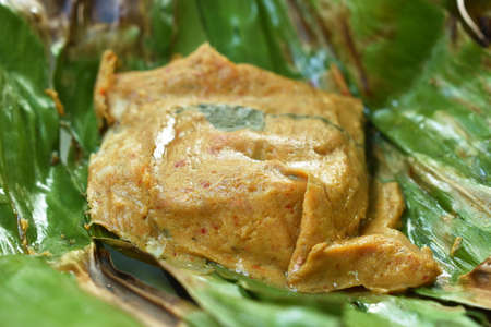 grilled curry fish and swimmer crab meat wrapped in banana leaf