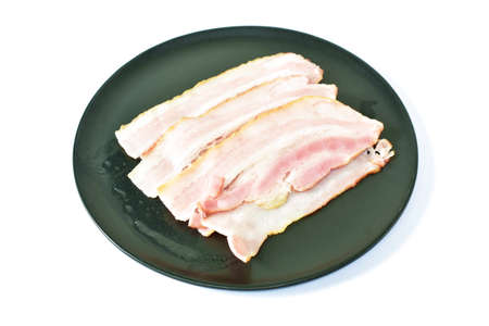 steamed slice pork bacon arranging on plate in white background Фото со стока