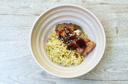 Chinese egg noodles roasted chicken dressing Teriyaki Japanese sauce on bowl