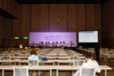 blur of stage and people meeting  in conference room