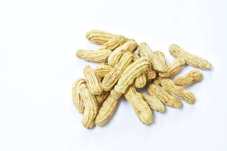 boiled peanuts with peel on white background Imagens