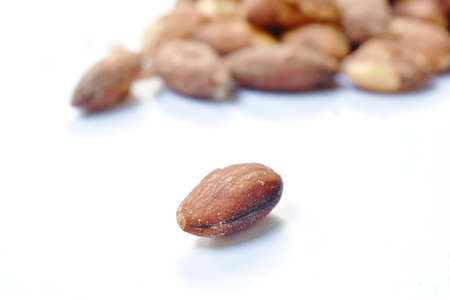 baked almond seed batch on white background