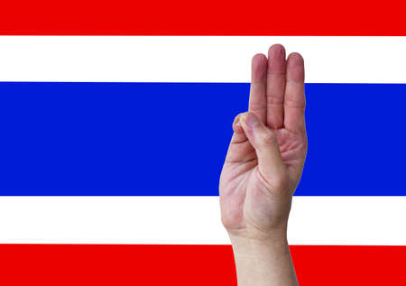 hand with three finger symbol for Thai youngbloods and students protesting to government in Thailand on flag background 写真素材