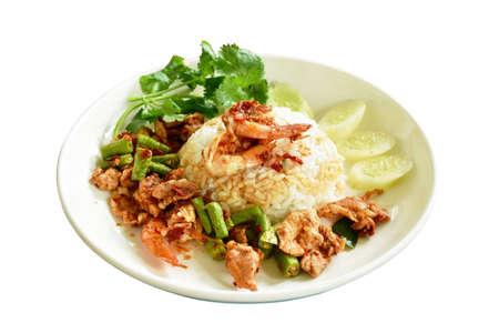 spicy fried shrimp and slice soft pork with curry sauce topping plain rice on plate Фото со стока