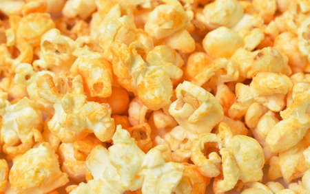 salty baked cheese popcorn arranging on white background