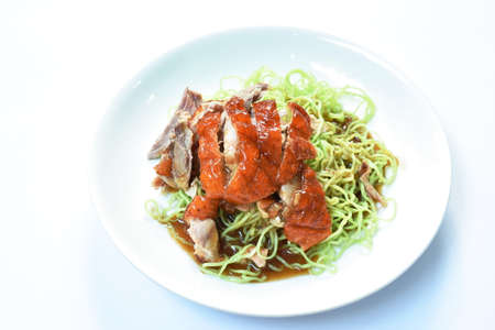 Chinese jade noodles topping slice roasted duck dressing sweet soy sauce on plate