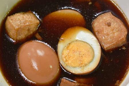 boiled half cut egg with tofu in herb brown soup on bowl Zdjęcie Seryjne
