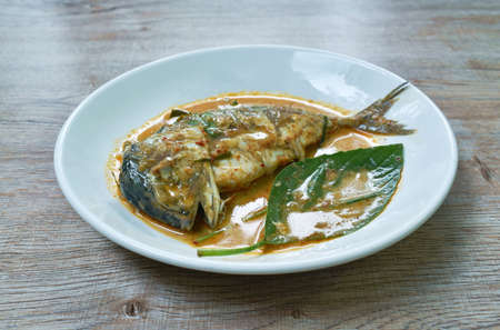 spicy boiled mackerel in red curry sauce on dish