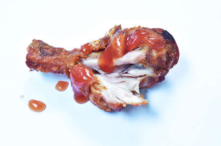 crispy fried chicken leg dressing ketchup sauce on white background Banque d'images