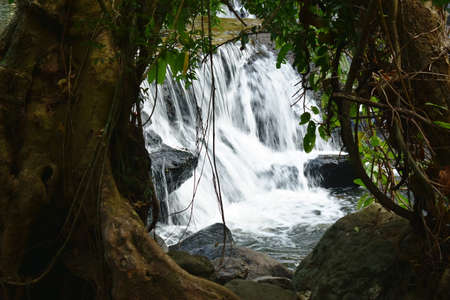 water falling on river pass rock and stone at Nang Rong waterfall travel location in Thailand