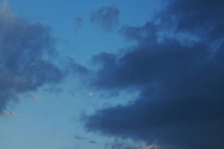 full moon on bright sky in evening