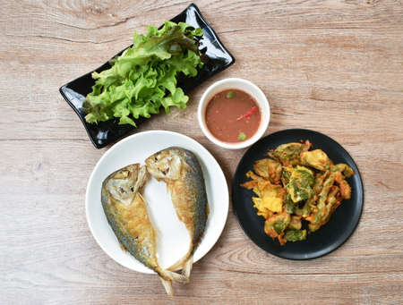 deep fried mackerel fish dipping spicy shrimp paste sauce eat with fried egg and fresh vegetable on plate