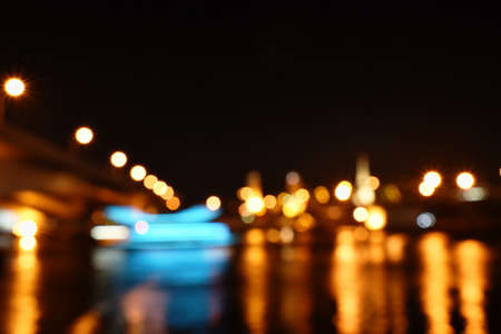 blurry light of building on river background and texture