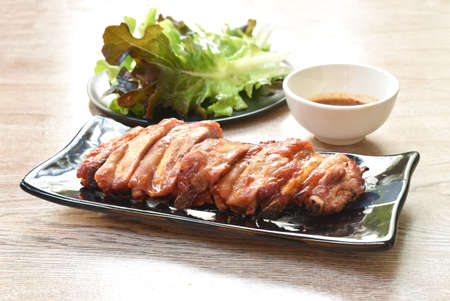 grilled pork bone slice dipping spicy chili sauce eat couple fresh vegetable on plate Stok Fotoğraf