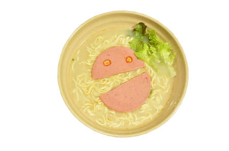 boiled instant noodles in soybean soup topping chili pork bologna half cut look like smile face on bowl