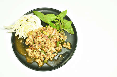 Thai spicy chop pork salad and fresh vegetable on plate