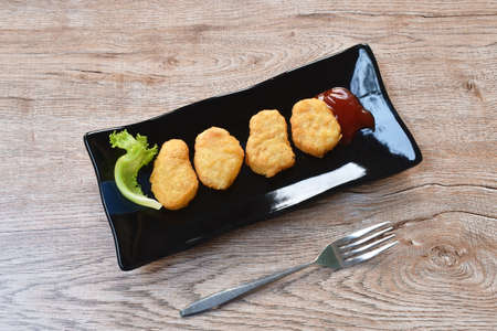 fried chiken nugget meat dipping ketchup on plate Stockfoto