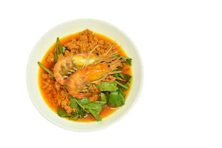 stir fried river shrimp in yellow curry and egg on plate